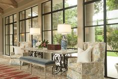 Jenkins interiors - black window detail, blue and white lamps, fabric on chairs, gray velvet bench