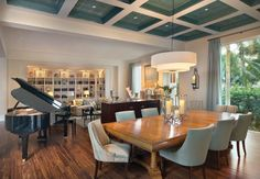 | The dining room's coffered ceiling is green Venetian plaster with a ...