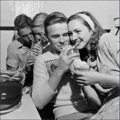 1950's teenagers hanging out at the soda shop