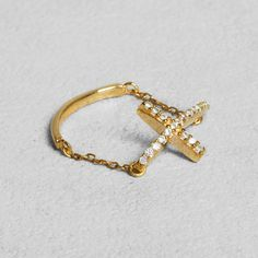 Petit Sesame | Gold-plated shiny cross ring | Designed by Petit sesame | $15.00 | 18k gold plated 925 sterling silver flexible ring adorned with a cubic zirconia cross