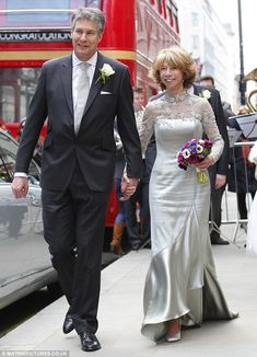 Helen Worth has played Gail Platt in Corrie for over 40yrs, where she has been married 4 times! This photo shows her real life wedding to teacher Trevor Dawson in April 2013.  The couple emerged from St. James' Church in Piccadilly, having made their vows.