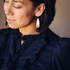 Textured silver earrings in a long drop shape by bluehourdesigns, $37.00