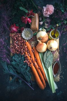 Ingredients for vegetarian Red Beans and Rice: red beans, carrots, celery, bay leaf, smoked paprika, kale, peanut oil, and brown rice.