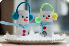 Toilet paper tube snowmen with earmuffs made out of pipe cleaners and pom poms by josie