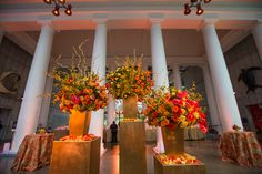 Yellow and red flowers are accented with kua branches to give these grand florals a whimsical touch.