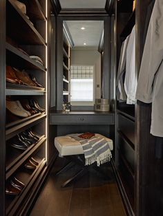 Bespoke dressing area for him in dark wood, fitted, custom joinery, recessed, hidden ambient lighting. Shelving, wardrobes and dressing table