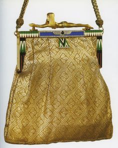 Art Deco evening bag, circa 1925, 18K gold, diamonds, onyx, emeralds, silk, and enamel.
