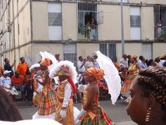 French Guiana's People: this shows the outfits they would wear if there was a parade in the streets and the kinds of things they hold when they are actually in the parade.