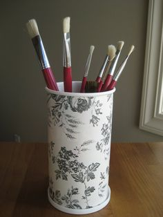 repurposed oatmeal container using contact paper