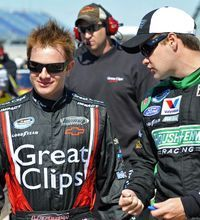 Ricky Stenhouse Jr., right, talks with Jason Leffler during qualifying for a Nationwide Series race at Chicagoland Speedway on Spet. 17, 2011.
