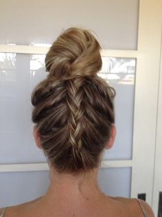 A French braided undo with a knot on top makes for a fun situation for the person sitting behind you at the beach.