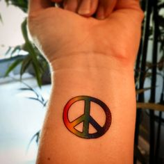 Peace sign tattoo rainbow colored peace sign by SharonHArtDesigns