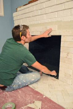 Fireplace Makeover: Tiling The Mantel With Marble Herringbone Learn how to tile a brick fireplace surround with this tutorial from John & Sherry of Young House Love Fireplace Seating, Paint Fireplace, Limestone Fireplace, Small Fireplace, Home Fireplace, Fireplace Remodel, Brick Fireplace, Fireplace Surrounds, Fireplace Design