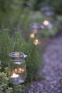 Karin Lidbeck, mason jars as garden edging lights. Wonder if I could find solar lights that could go in them. Mason Jar Garden, Mason Jars, Canning Jars, Glass Jars, Outdoor Lighting, Outdoor Decor, Lighting Ideas, Pathway Lighting, Backyard Lighting