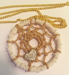 "Pretty boho style authentically woven lace dreamcatcher necklace with gold colored heart charm and gold colored 36"" chain by EarthDiverCreations on Etsy https://www.etsy.com/ca/listing/482535886/pretty-boho-style-authentically-woven"