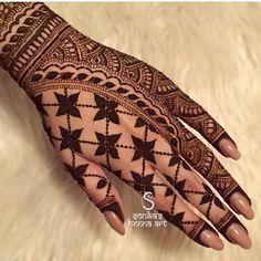 Beautiful Punjabi phulkari-inspired henna by Sonika's Henna Art.