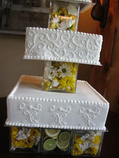 Favorite cake ever. I love the yellow flowers and limes/lemons in the glass between each level!