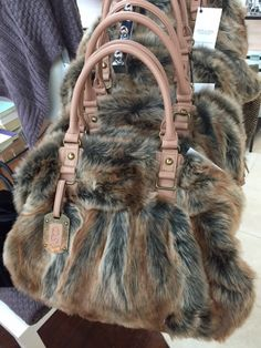 We have the must-have bag for fall and winter! Isn't it fabulous? It's faux coyote! You have to see this stunner for yourself.
