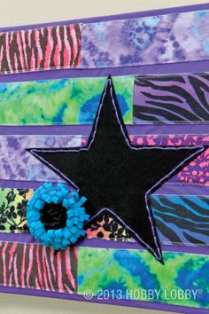 We zigzag-stitched wide strips of felt to basic cotton fabric for this on-canvas design. Then we added a simple star appliqué and a two-toned felt flower!