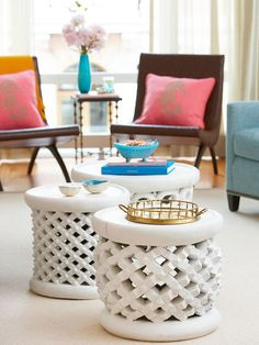 I love flexible furnishings like this! Grouping several garden stools as a coffee table is a great small space solution! You can easily move them around for parties and create more space in the center of the room when you need it. Love it!
