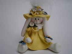 Easter Bunny Rabbit holding a Butterfly-Polymer by HelensClayArt