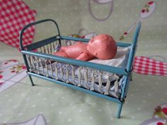 """Vintage Dolls House Miniature Metal Bed/Cot/Crib, Bedding & Baby Doll - 4""""x3"""""""