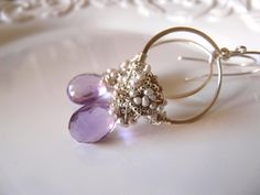 Clustered hoops with faceted amethyst