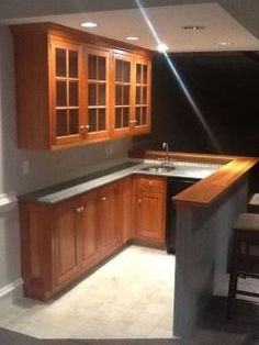 Small Basement Bar Design, Pictures, Remodel, Decor and Ideas. I love small bars downstairs but often look cheap and ugly. This one is perfect!