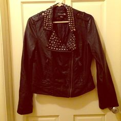 Forever 21 Faux Leather Jacket Gently warn, like new faux leather jacket, front zipper, studded neckline (no studs are missing), zippers on the wrists, two pockets in front. Forever 21 Jackets & Coats Utility Jackets