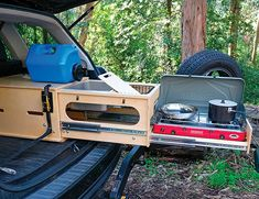 The Nomad Kitchen is a handy slide-out car camping kitchen that fits in nearly any hatchback or SUV, yet can take on 200 pounds of weight and 14 gallons of water. Truck Camper, Truck Bed Camping, Minivan Camping, Camping Stove, Camper Trailers, Best Cars For Camping, Camping Trailer Diy, Camping Hammock, Accessoires Camping Car