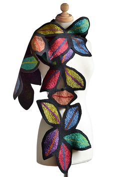 Lana Scarf by Elizabeth Rubrige. Hand-dyed silk leaves felted over black merino wool create a warm, whimsical scarf with a colorful stained-glass look.