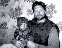 Sergeant Chapman holding a young girl in a tent in Afghanistan during a blizzard in the winter of 2002, not long before he died.