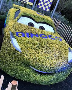 There's a Cars 3 spoiler in this picture from Epcot's Flower & Garden Festival.    #cars #cars3 #pixar #epcot #topiary #playground #wdw #disney #twitter #dinoco #disneypixar #disneyworld