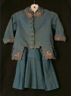 1877-1880 Dress, boy's, bright blue wool twill, plaid wool, and challis bodice, via Wisconsin Historical Museum Online Collections.
