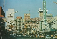 Fremont Street, Las Vegas, decorated for Christmas in this vintage / old photo.
