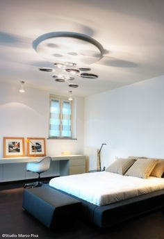 #Mercury ceiling #design Ross Lovegrove and the #Tolomeo Micro table lamps, orange finish in this beautiful bedroom.