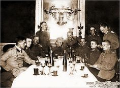 Oswald Boelcke sitting far right with Erwin Bohme standing behind him.