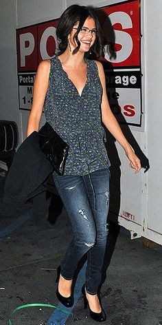 Selena looks all grown-up in a plunging floral tunic over skinny distressed jeans and black patent pumps for dinner in Los Angeles.