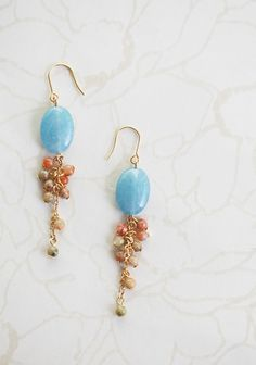 """Dream Weaver Earrings 16.99 at shopruche.com. These gold colored earrings feature cloudy blue stones dripping with clusters of complementary earth tone beads.2"""" long"""