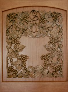 Agrell Architectural Carving - wood carved door panel for wine cellar - hand carved in mahogany