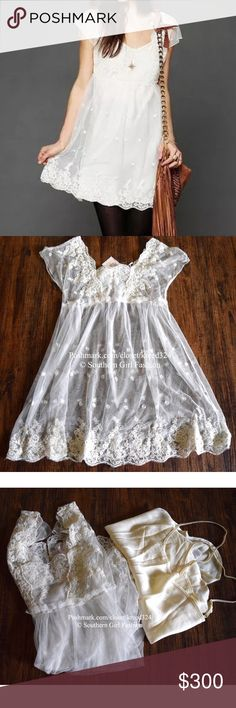 FREE PEOPLE Dress Lace Embroidered Mesh Swing Mini Size XS.   New with tags.  $168 Retail + Tax.   • Beautiful embroidered off-white mini dress featuring sheer lace mesh detailing throughout & swingy silhouette.  • Mini Slip lining included.  • Lace crochet detailing at chest & bottom hem. • Button opening at back. • Polyester. • Measurements in comment(s) below.  {Southern Girl Fashion - Closet Policy}   ✔️ Same-Business-Day Shipping (10am CT). ✔️ Reasonable best offer considered when…