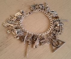 This is absolutely adorable!! Ultimate Harry Potter Charm Bracelet  Simply by MistressJennie, $80.00