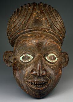 unknown Kom Kingdom artist (Kom Kingdom, Cameroon Grassfields), Helmet Mask , late 19th century, iroko wood and kaolin The Portland Art Museum