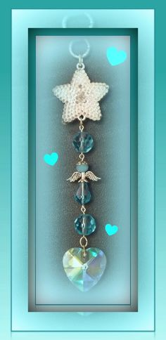 SHINING STAR OF MY HEART: This rear vision hanger has been fashioned to remind you that your precious angel is forever embedded in the safety of your heart. Turquoise has been chosen as the focal colour as many people regard turquoise as the stone of communication...... you and your inner treasure always remain connected through ♥. A beautiful AB faceted crystal heart finishes off this 16cm hanger. Email angels.of.the.heart@gmail.com www.facebook.com/angelsoftheheart