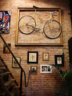 A Bicycle in a frame with pictures of the bike rides?