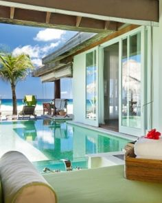 Maldives - In Ocean Houses, alfresco bathrooms blend into private pools and the Indian Ocean beyond. #Jetsetter