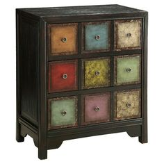 With its hand-painted multicolored drawers and distressed details, this apothecary-inspired chest is the perfect addition to a bohemian or eclectic space. Se...