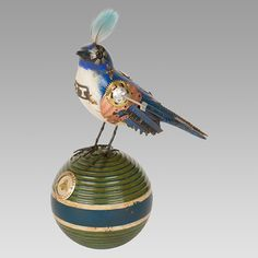 Scrubjay with Feather on Croquet Ball. Designed by Mullanium whose work is available at Human Arts in Ojai. Steampunk Bird, Human Art, Bird Art, Recycled Materials, Wood Carving, Paper Art, Christmas Bulbs, Recycling, Birds
