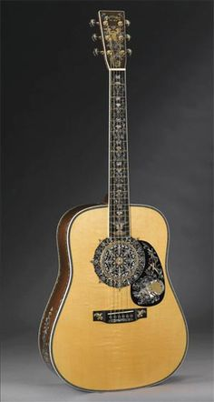 Martin's 1,000,000th guitar.  Brazilian rosewood, black African ebony, Adirondack red spruce, and mahogany.