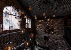 Luchetti Krelle completes Sydney bar based on a New York loft dezeen.com